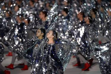 Dancers perform during the Closing Ceremony of the Sochi Winter Olympics at the Fisht Olympic Stadium on February 23, 2014.    AFP PHOTO / PETER PARKS