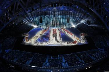 Athletes arrive during the closing ceremony of the 2014 Winter Olympics, Sunday, Feb. 23, 2014, in Sochi, Russia. (AP Photo/David J. Phillip )