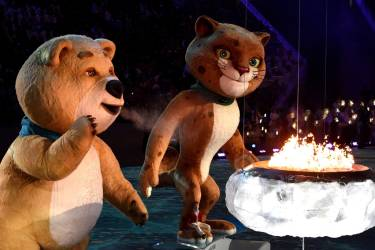 The polar bear mascot extinguishes the Olympic Flame during the Closing Ceremony of the Sochi Winter Olympics at the Fisht Olympic Stadium on February 23, 2014. The 2018 Winter Olympic games are scheduled to take place in Pyeongchang, South Korea.   AFP PHOTO / ANDREJ ISAKOVIC