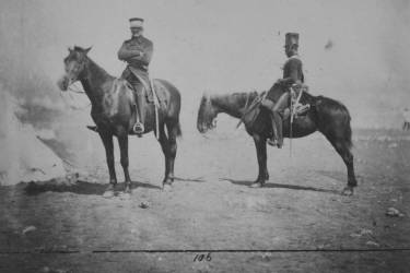 General Sir John L. Pennefather, full-length portrait, wearing uniform, seated on horse, and orderly, also full-length, in uniform of 4th Light Dragoons, seated on horse.