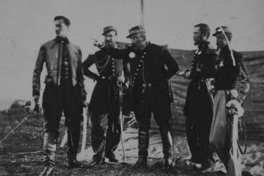General Pierre Bosquet standing between four officers, gesturing to the left.