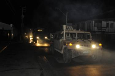 A military vehicle patrols after an earthquake in Iquique, Chile, Tuesday, April 1, 2014. A powerful magnitude-8.2 earthquake struck off Chile's northern coast Tuesday night. A powerful magnitude-8.2 earthquake struck off northern Chile on Tuesday night, setting off a small tsunami that forced evacuations along the country's entire Pacific coast. (AP Photo/Cristian Viveros) NO PUBLICAR EN CHILE