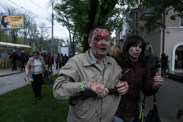 A pro-Ukrainian protester attacked by pro-Russian activists while an attempt to hold a peaceful pro-Ukrainian march in downtown of Donetsk, Eastern Ukraine.