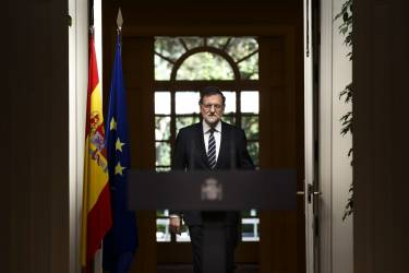 Spain's Prime Minister Mariano Rajoy enters the room to deliver a statement in the Moncloa Palace, Madrid, Spain, Monday, June 2, 2014. Spanish Prime Minister Mariano Rajoy announced in a press conference that King Juan Carlos plans to abdicate and pave the way for his son, Crown Prince Felipe, to become the country's next king. The 76-year-old Juan Carlos oversaw his country's transition from dictatorship to democracy but has had repeated health problems in recent years. His popularity also dipped following royal scandals, including an elephant-shooting trip he took in the middle of Spain's financial crisis that tarnished the monarch's image. The king came to power in 1975, two days after the death of longtime dictator Francisco Franco. (AP Photo/Daniel Ochoa de Olza)