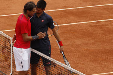 Rafael Nadal of Spain (L) shakes hands with Novak Djokovic of Serbia after winning their men's singles final match at the French Open tennis tournament at the Roland Garros stadium in Paris June 11, 2012.                     REUTERS/Benoit Tessier (FRANCE  - Tags: SPORT TENNIS)   - RTR33FFO