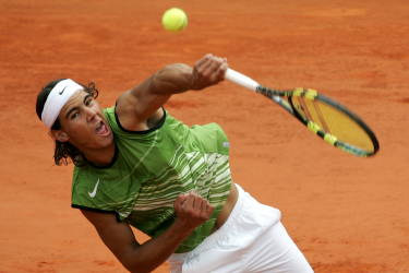 Spain's Rafael Nadal, fourth seed, serves the ball to [Argentina's Mariano Puerta] during their men's final match in the French Open tennis tournament at the Roland Garros stadium, in Paris, June 5, 2005. - RTXNJWZ