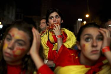 Spanish soccer fans watch on a giant display as the Netherlands soccer team wins the World Cup soccer match between Spain and Netherlands, in Madrid, Spain, Friday, June 13, 2014. (AP Photo/Daniel Ochoa de Olza)