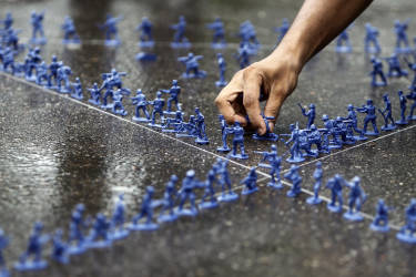 A Bangladeshi student makes a formation, using toy soldiers, representing the star of David during a demonstration by students of Dhaka University against Israeli attack on Gaza in Dhaka, Bangladesh, Wednesday, July 16, 2014. (AP Photo/A.M. Ahad)