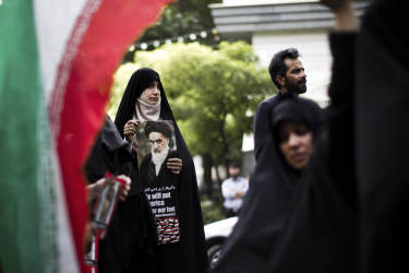 Iranian women hold anti-Israel placards and portraits of the late founder of the Islamic republic Ayatollah Ruhollah Khomeini outside the United Nations offices in Tehran on July 15, 2014 during a demonstration held by a small group of protestors against Israel's air strikes on the Gaza Strip this month. AFP PHOTO/BEHROUZ MEHRI