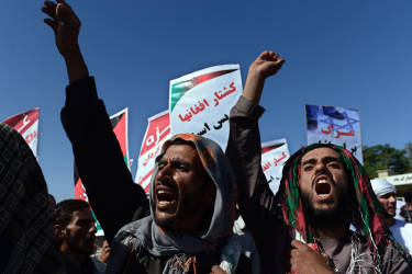 Afghan demonstrators shout slogans against Israeli attacks on Palestinian territories during a demonstration in front of the Eid Gah Mosque in the city of Kabul on July 18, 2014. Israel warned July 18 it could broaden a Gaza ground assault aimed at smashing Hamas's network of cross-border tunnels, as it stepped up attacks that have killed more than 260 Palestinians. AFP PHOTO/Wakil Kohsar