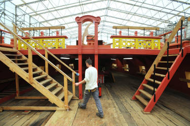 A man works on July 19, 2011 in Rochefort, western France, on the construction site of a replica of the Hermione, the frigate on which La Fayette embarked in 1780, to bring help and support to the American insurgents. The Launched in 1997, the project aims to build a boat nearly identical to the Hermione, which sank off Croisic (Loire-Atlantique) in 1793, for a transatlantic crossing in 2015, before turning the ship into a museum.  AFP PHOTO XAVIER LEOTY