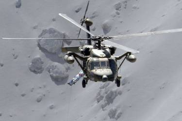 An injured person is lifted by a rescue helicopter of Japan Self-Defense Force (JSDF) at Mt. Ontake, which straddles Nagano and Gifu prefectures in this September 28, 2014 photo taken and released by Kyodo. More than 500 Japanese military and police set out on Sunday to search the peak of a volcano popular with hikers a day after its sudden eruption trapped hundreds on the mountain for hours, amid conflicting reports about missing and injured climbers.   Mandatory credit.   REUTERS/Kyodo (JAPAN - Tags: DISASTER ENVIRONMENT SOCIETY) 