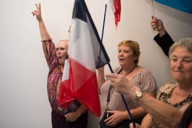 French far right party Front National (FN) new senator Stephane Ravier's supporters celebrate on September 28, 2014 in Marseille, southern France, after the results of the French Senate elections. Just three years after France's upper house Senate made history with its first ever swing to the left, the right was expected to claw back a majority Sunday in a new setback for Socialist President Francois Hollande. The far-right National Front won two seats for the first time. AFP PHOTO / BERTRAND LANGLOIS