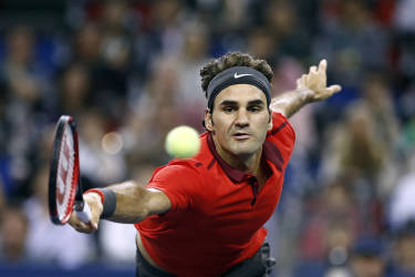 Roger Federer of Switzerland returns a shot to Gilles Simon of France during the men's singles final match at the Shanghai Masters tennis tournament in Shanghai October 12, 2014. REUTERS/Aly Song (CHINA - Tags: SPORT TENNIS TPX IMAGES OF THE DAY) - RTR49UAE
