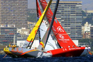 Team Abu Dhabi Ocean Racing (L) and Dongfeng Race Team sail during a in port Race of the Volvo Ocean Race sailing regatta in Alicante on October 4, 2014.  AFP PHOTO / JOSE JORDAN