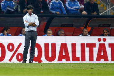 Germany's coach Joachim Loew reacts after a goal of Poland's Sebastian Mila (not pictured) during their Euro 2016 group D qualifying soccer match at the National stadium in Warsaw October 11, 2014. REUTERS/Kacper Pempel (POLAND  - Tags: SOCCER SPORT)   - RTR49T3N