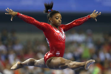 Simone Biles of the U.S. competes on the balance beam during the women's team final event at the 2014 World Artistic Gymnastics Championships in Nanning, Guangxi Zhuang Autonomous Region, October 8, 2014. The United States defended their women's team title at the championships on Wednesday with a victory over hosts China, with Russia claiming third. REUTERS/China Daily (CHINA - Tags: SPORT GYMNASTICS) CHINA OUT. NO COMMERCIAL OR EDITORIAL SALES IN CHINA - RTR49EYS