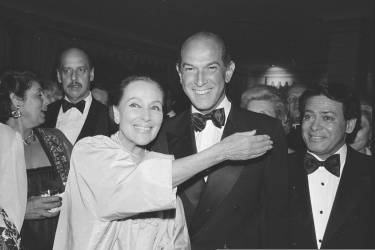 FILE - In this May 7, 1981, file photo, fashion designer Oscar de la Renta and actress Dolores del Rio are pose at the Casita Maria Benefit dinner at the Pierre Hotel in New York where the two were honored. The fashion designer, a favorite of socialites and movie stars alike, has died. He was 82. (AP Photo/File)