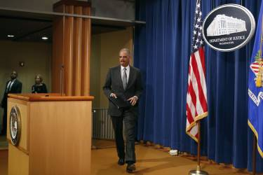 U.S. Attorney General Eric Holder arrives to make a statement about the grand jury decision not to seek an indictment in the Staten Island death of Eric Garner during an arrest in July, in Washington December 3, 2014. A New York City grand jury decision not to charge white police officer Daniel Pantaleo who killed unarmed black man Garner with a chokehold sparked outrage and protests on Wednesday, and the U.S. Justice Department said it would investigate the incident. REUTERS/Yuri Gripas (UNITED STATES - Tags: POLITICS CRIME LAW)